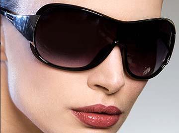 Dark noir sunglasses, £10, Next
