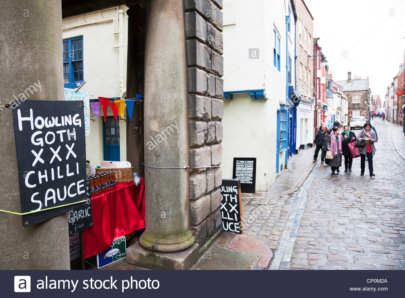 whitby-town-north-yorkshire-uk-england-market-stall-selling-howling-CP0M2A